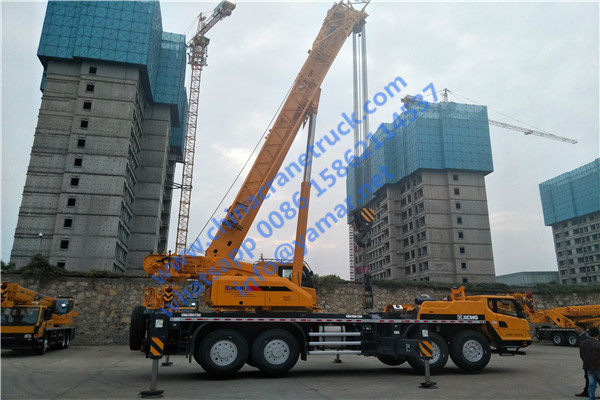 We inspect QY75K truck crane in factory